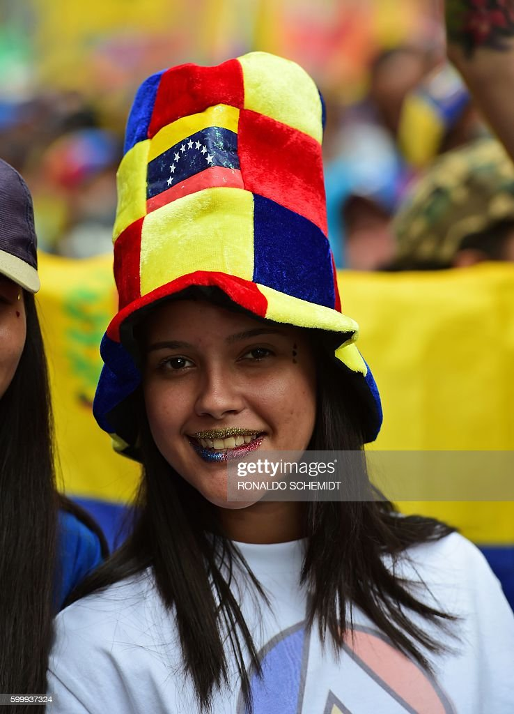 A girl demonstrates against President Nicolas Maduro, in Los Teques, Miranda State, Venezuela, on September 7, 2016 as the country's opposition called for new nationwide protests to pressure for a referendum on removing him from power by the end of the year. Venezuela's opposition is holding nationwide protests against Maduro, testing his grip on power six days after massive demonstrations showed the magnitude of anger over a raging crisis. / AFP / RONALDO