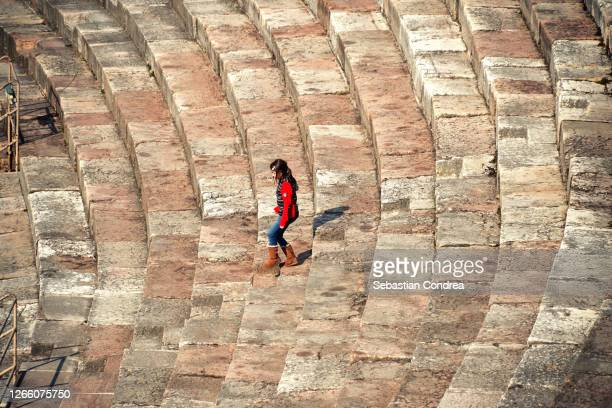girl descending the steps of the second largest roman arena in verona, italy - human kidney stock pictures, royalty-free photos & images