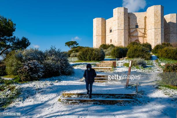 Girl descends from the hill of the Castel del Monte snow-covered by the snowfall of the night on January 18, 2021. The cold wave continues in Puglia,...