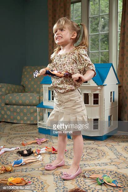 girl (4-5 years) destroying doll in room - 4 5 years stock pictures, royalty-free photos & images