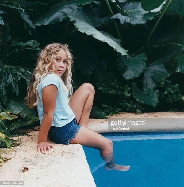 Girl Dipping Foot in Pool