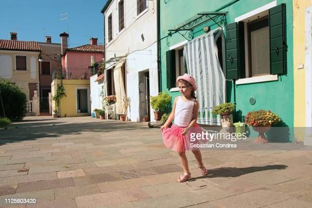 girl discovering the beautyful colorful italian town burano near venice,italy - murano stock pictures, royalty-free photos & images
