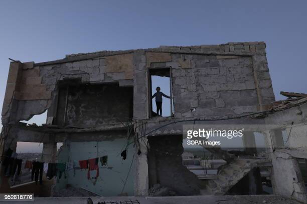 AHRAS AFRIN ALEPPPO SYRIA A girl displaced from Efrin stand outside her new home in the village of Ahras An estimated 400000 refugees fleeing the...