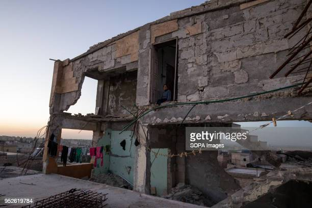 A girl displaced from Efrin stand outside her new home in the village of Ahras An estimated 400000 refugees fleeing the twomonthold Turkish military...