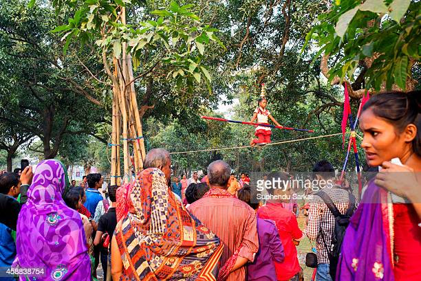 A girl displays ropewalking skill at the Sonepur fair ground The Sonepur Cattle Fair is the largest cattle fair in Asia and begins every year on the...