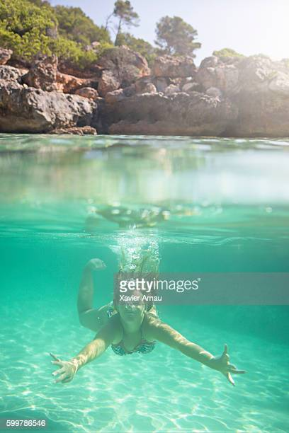 girl diving underwater - bottomless girls stock photos and pictures
