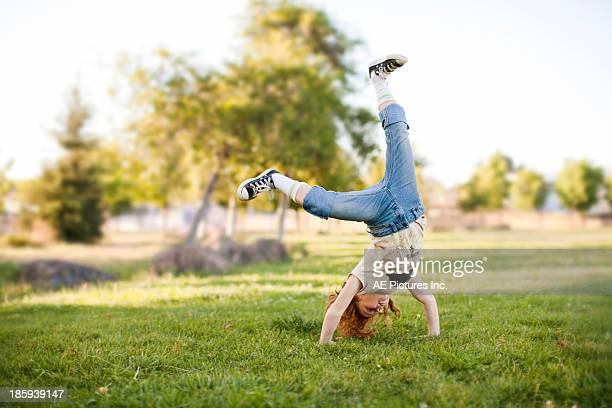 girl does cartwheel - legs apart stock pictures, royalty-free photos & images