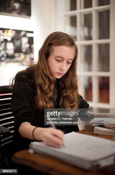 girl does homework - joseph o. holmes stock pictures, royalty-free photos & images