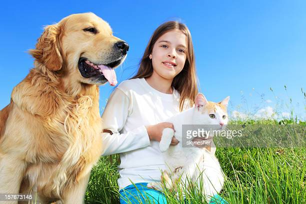 girl, dog and cat relaxing in nature. - cat family stock pictures, royalty-free photos & images