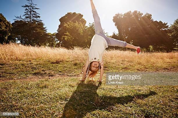Girl (8-10) doing a cartwheel