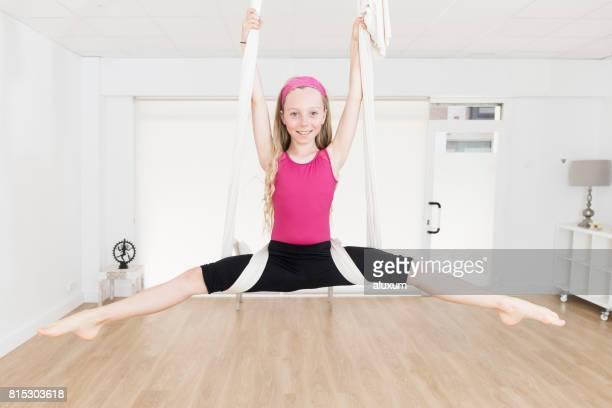 Girl doing aerial yoga exercises