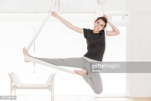 Girl doing aerial yoga