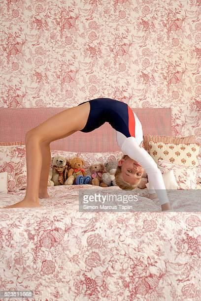 Girl Doing Backbend on Bed