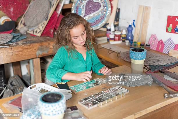 Girl doing crafts in home garage