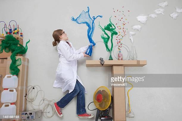 girl doing experiment - 横向きに寝る ストックフォトと画像