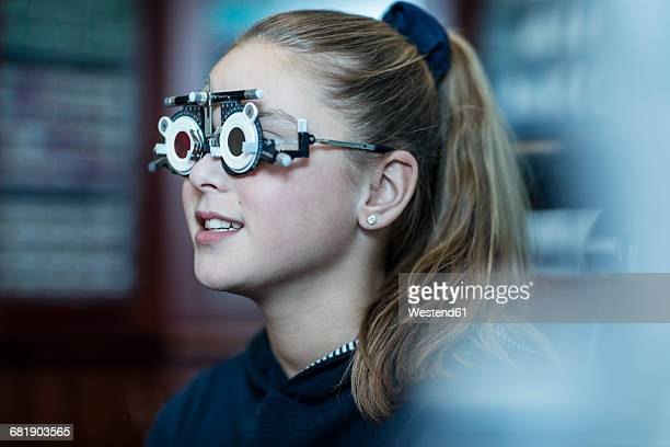 Girl doing eye test at optometrist