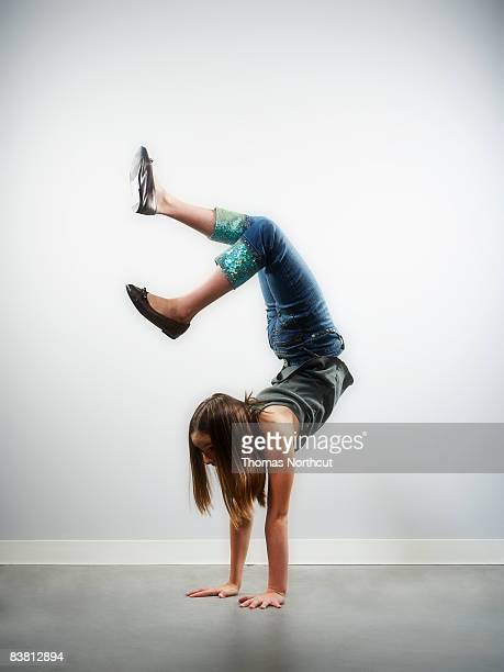 girl doing handstand - cartwheel stock pictures, royalty-free photos & images