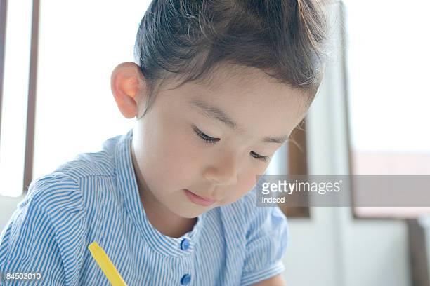Girl doing her homework, looking down