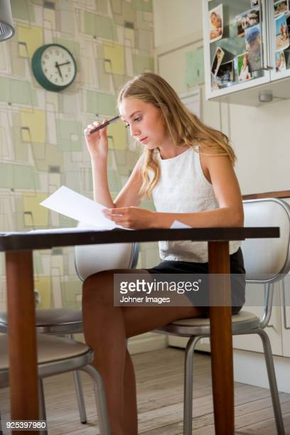 girl doing homerwork - one teenage girl only stock pictures, royalty-free photos & images