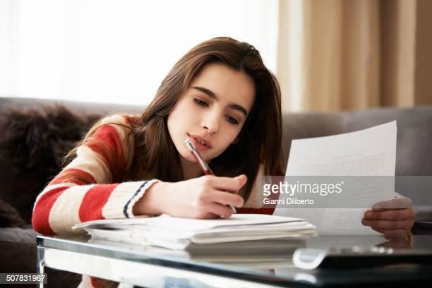 Girl doing homework at coffee table