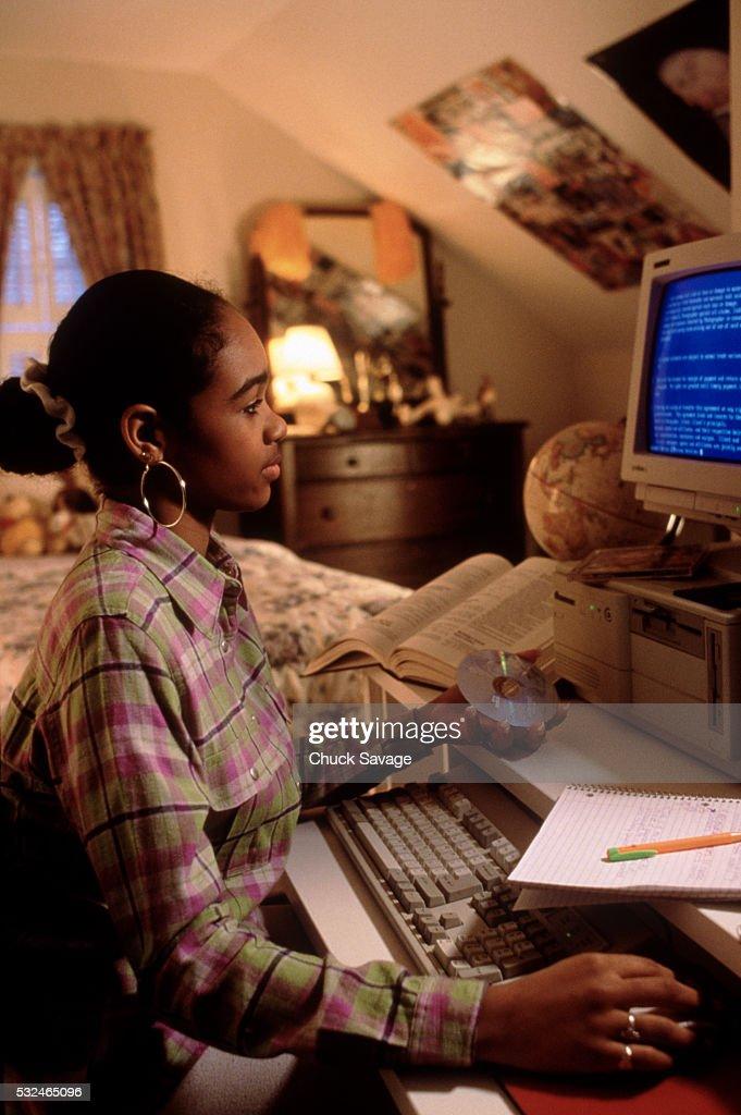 A Teenage Girl Doing Homework High-Res Stock Photo - Getty
