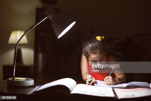 girl doing homework at home - children only stock pictures, royalty-free photos & images