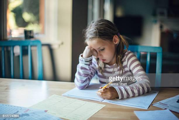 Girl doing homework at table