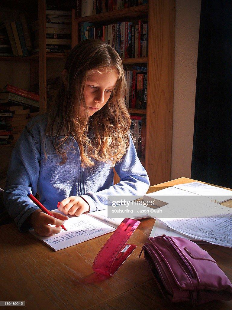 Girl doing homework : Stock Photo