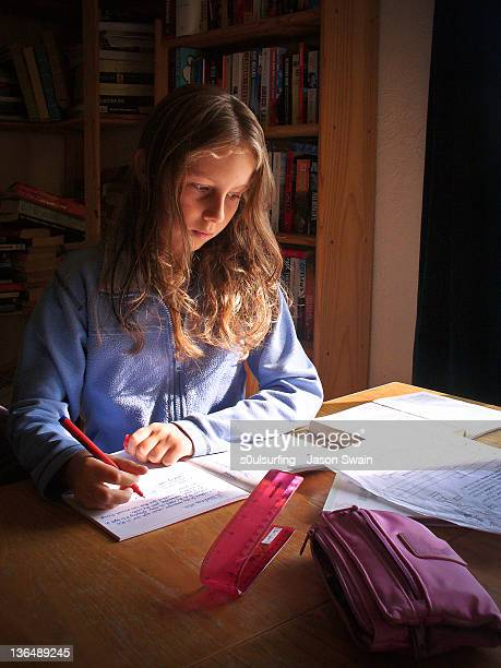 girl doing homework - s0ulsurfing stock pictures, royalty-free photos & images