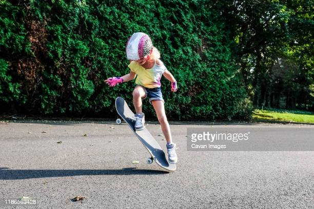 girl doing ollie outside on skateboard - ollie pictures stock pictures, royalty-free photos & images