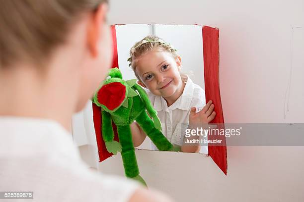 girl doing puppet show - puppet show stock photos and pictures