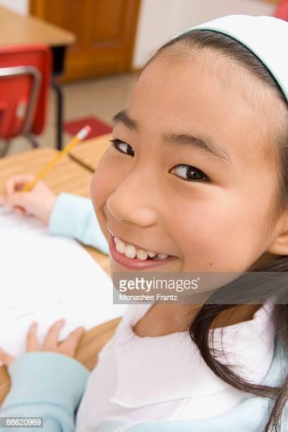 Girl doing school work in classroom
