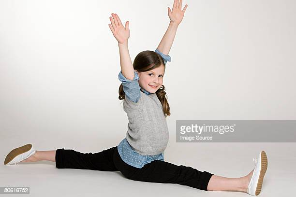 a girl doing the splits - doing the splits stock photos and pictures