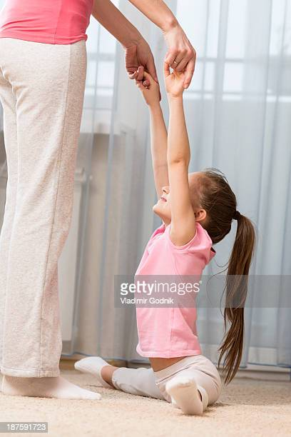 girl doing the splits with a little help from her mother - little russian girls stock photos and pictures