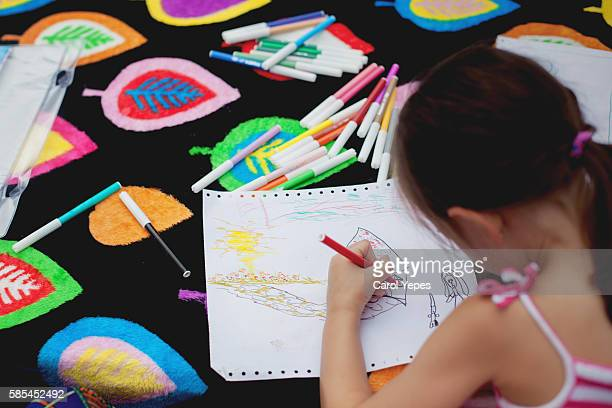 girl drawing and painting with colors