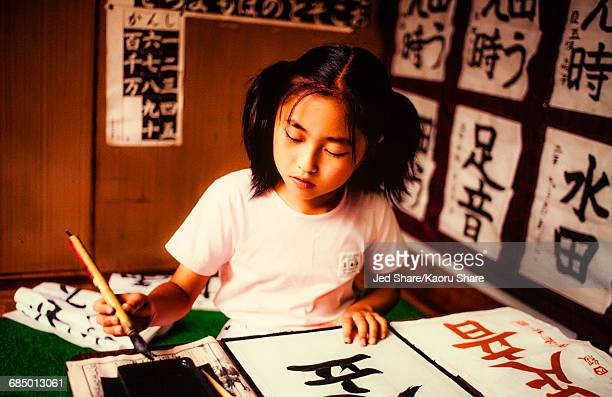 Girl drawing Japanese script