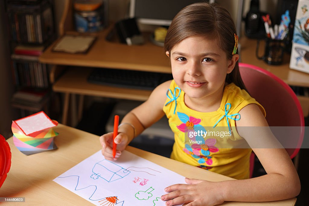Girl drawing on a paper : Foto de stock