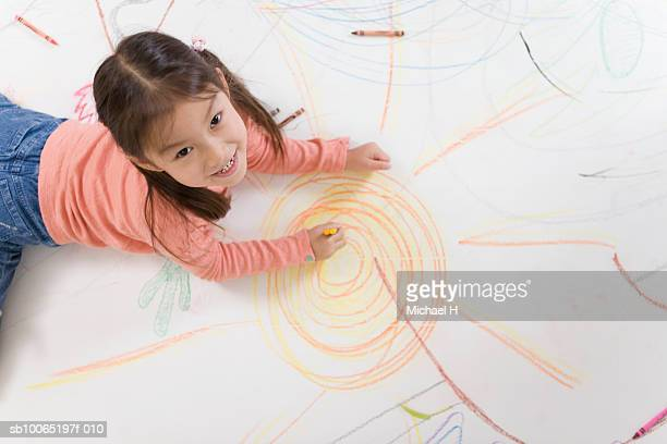 girl (4-5 years) drawing on floor with crayons, elevated view, portrait - 4 5 years stock pictures, royalty-free photos & images
