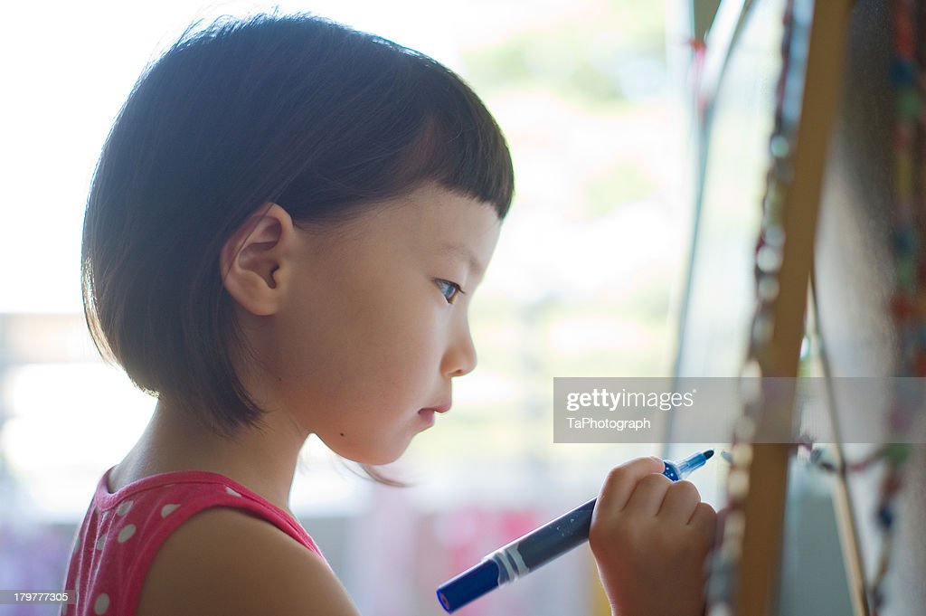 Girl drawing picture : Stock Photo