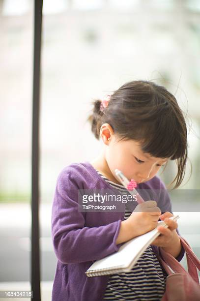 Girl drawing picture with concentration