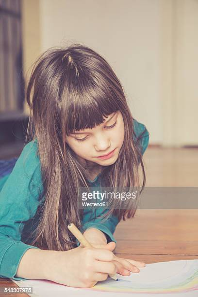 Girl drawing rainbow