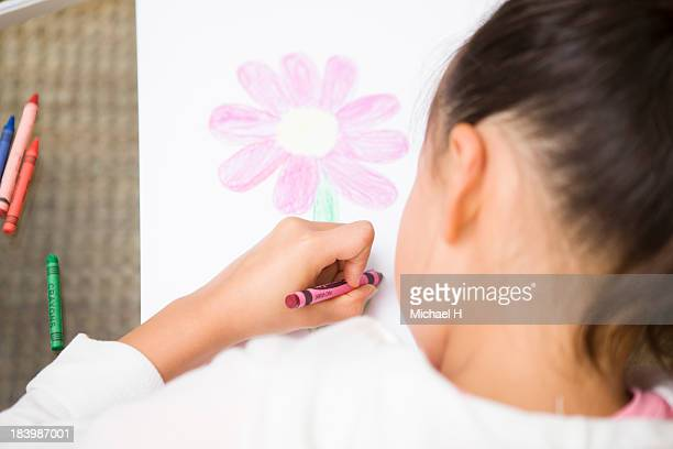 A girl drawn picture  seriously
