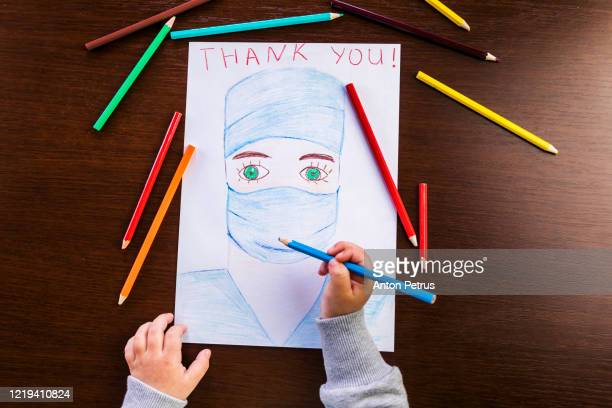 girl draws a doctor in a mask. thanks to the medical staff - thank you stock pictures, royalty-free photos & images