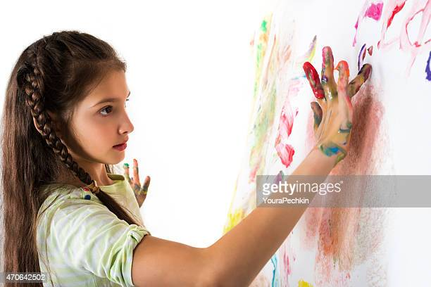 Girl draws fingers on paper wall
