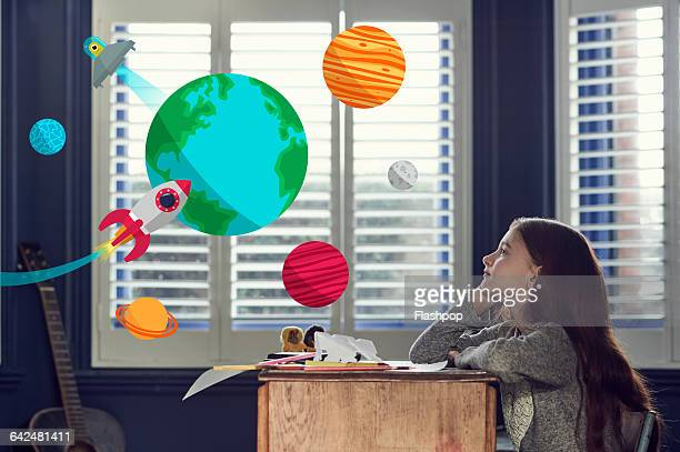 girl dreaming about space and planets - fantasiewelt stock-fotos und bilder
