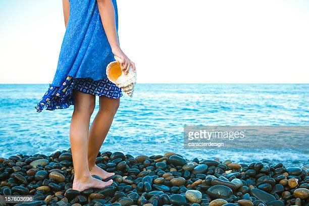 girl dreaming at the beach - conch shell stock pictures, royalty-free photos & images