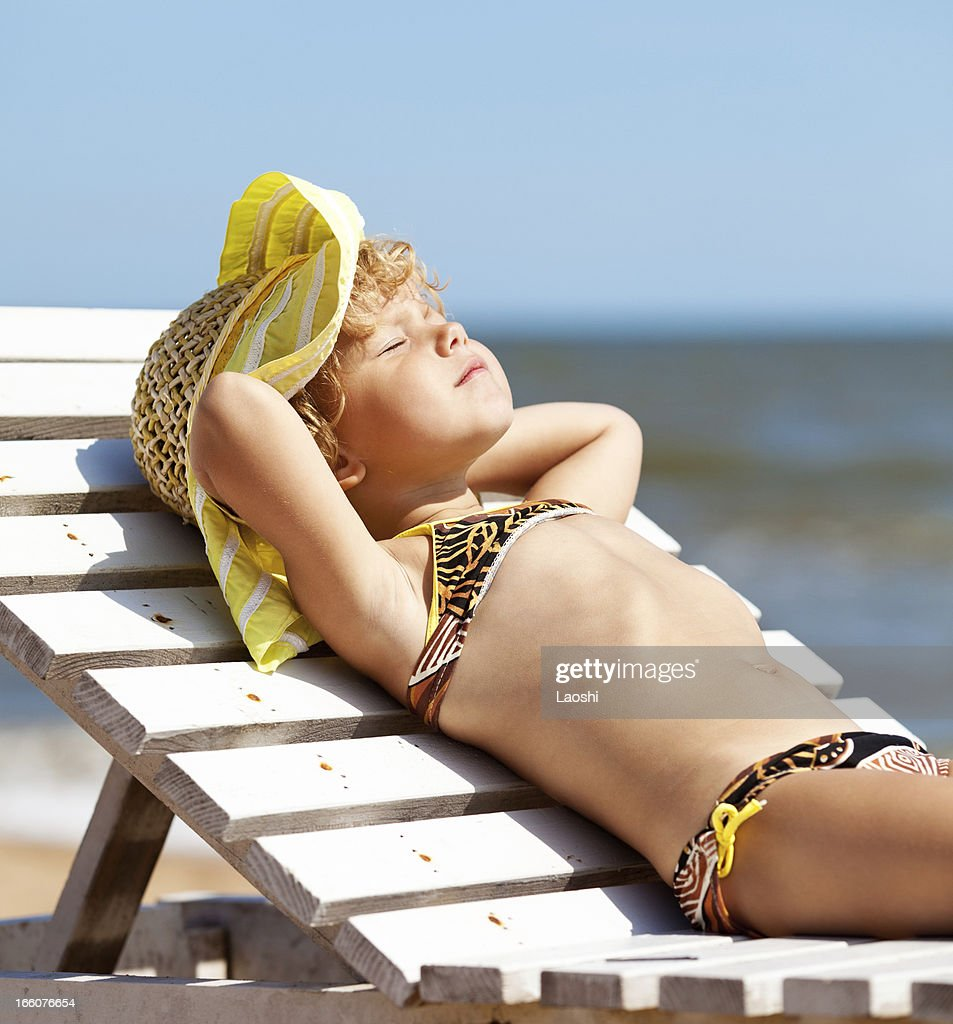 Girl dreaming at the beach : Stock Photo