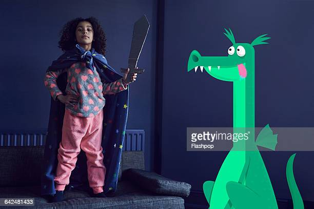 girl dressed as a knight with dragon - children only stock pictures, royalty-free photos & images