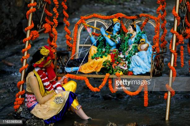 Girl dressed as a lord Krishna poses for a photo during the celebratio of Krishna Janmasthami the birthday of Lord Krishna in Kathmandu,Nepal on...