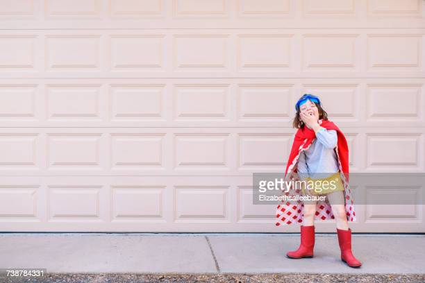 Girl dressed as a superhero